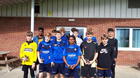 Diss Under-16s pose for a team picture at the Wisbech tournament, where they finished runners-up. Pi