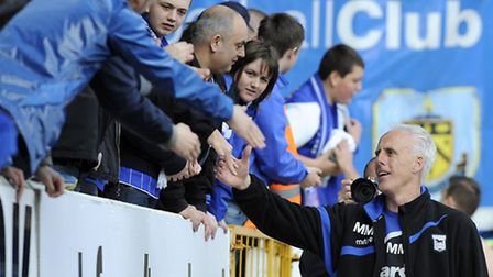 Mick McCarthy gets a good reception from the Town fans at Burnley after Ipswich's play-off hopes for