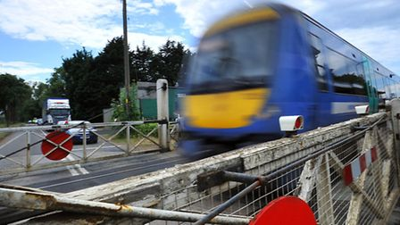 A Greater Anglia train on a level crossing