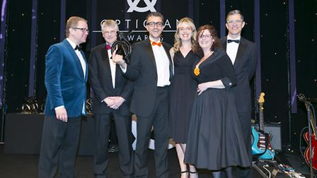 Members of staff from Observatory the Opticians, in Beccles, receiving the national award from Marti