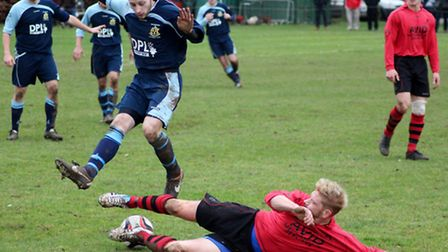 Action from Grundisburgh's (blue) 4-1 home victory over Achilles in January
