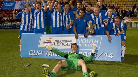 Colchester United Under-18s celebrate lifting the Youth Alliance National Cup after winning 4-2 at B