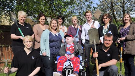 Staff from PPG are behind a project to build a sensory garden for Cheryl Middleton and her son Charl