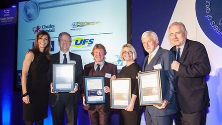 UFS owner and managing director Ray Ludlam, second from right, collecting the company's certificate