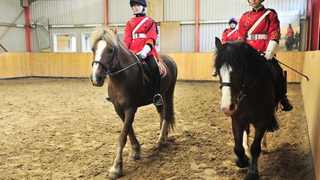 Members of the Suffolk Junior Cavalry get ready for their final parade