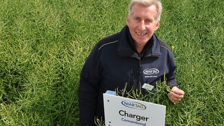 Simon Kightley, NIAB, in a field of Charger oilseed rape at Cereals 2013