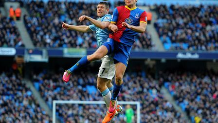 Manchester City's James Milner battles for the ball with Crystal Palace's Jonathan Parr