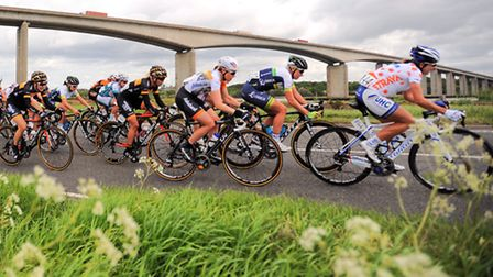 Women's Cycling Tour going past Orwell Bridge. Leading pack.