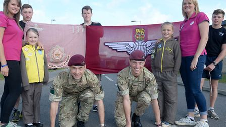 Two Army officers are racing for each other's jobs as they raise money to support a soldier's daught