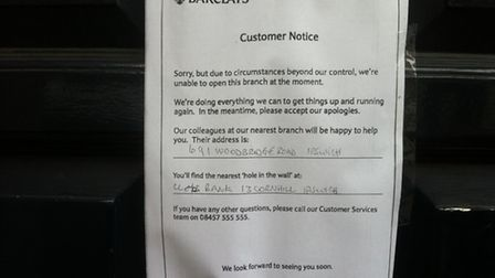 A sign posted on the door of Barclays Bank in Princes Street, Ipswich, today, informing customers th