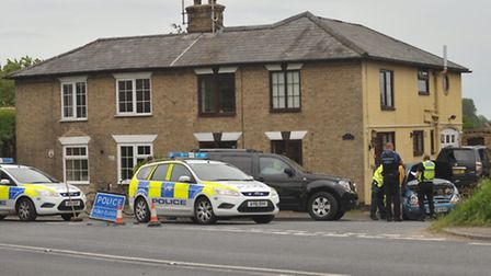 Police at the scene of the crash on the corner of the A12 and Angel Lane at Blythburgh.