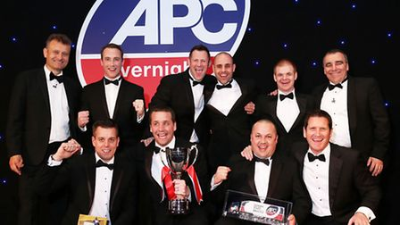 The Team C Express Logistics team celebrate the firm's APC Overnight Depot of the Year award with co
