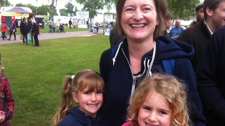 Joanne Hughes with her children watching Prince Harry arrive