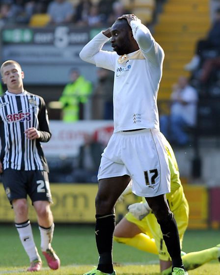 Jabo Ibehre holds his head after a near miss during the first half of the U's 2-0 defeat at Notts Co