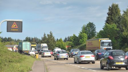 The A14 is congested in both directions due to an accident near Jimmy's Farm in Wherstead.