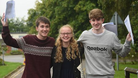 Students celebrate their A Level results at Diss High School. From left, Tom Knapp, Georgia Clark, a