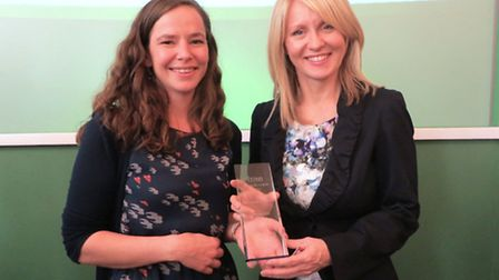 Amy Hardingham with Employment Minister Esther McVey, receiving the Enterprise of the Year and Gold