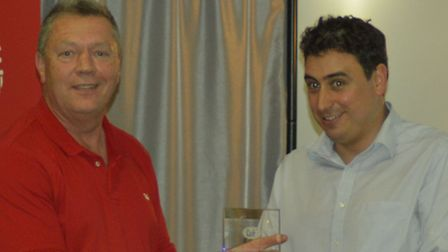 Ben Beavis [right] from PD Hook being presented with his trophy by John Vincent of Cobb Europe