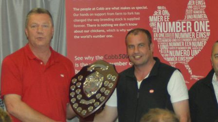 The winning team being presented with their shield by John Vincent [centre] of Cobb Europe. From le