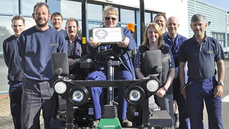 Ransomes Jacobsen safety representative Eddie Talbott, seated, with the RoSPA award, with Gemma Cosb