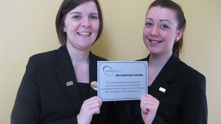 Katie Watson, left, front-desk manager and Madison La'Thangue, telephonist, with Bedford Lodge Hotel