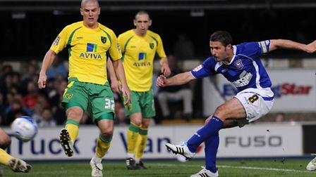 David Norris of Ipswich Town fires in a shot back in 2011
