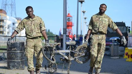 Soldiers from the 13 Air Assault Support Regiment aid in cleaning up the river Hythe in Colchester o