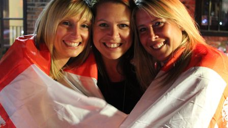 England fans draped in the flag of St George watch the England v Italy match at Isaacs on the Quay o