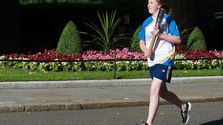 Molly Pattison takes the Queen's Baton to Downing Street, London, on Sunday