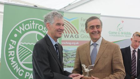 Farmer Ashley Cooper of Gestingthorpe receiving his Silver Lapwing trophy from the Duke of Westmins