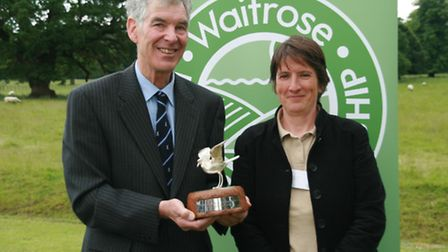 Ashley Cooper holding the FWAG Silver Lapwing Award, with Rebecca Inman, his FWAG Farm Environment A