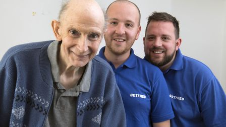 Betfred staff Jamie Scales (right) and Jack Bell saved the life of Michael Base, 72, after realising