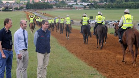 Left to right: William Gittus, John Morrey and Hugh Anderson watch as the horses ride past on Warren