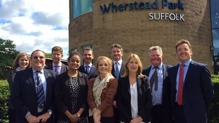 Members of the Ellisons team outside the firm's new Ipswich office at Wherstead Park. From left, Je