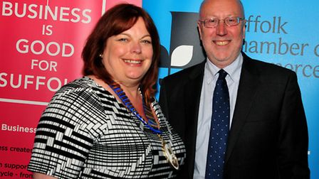 Sarah Howard, the new president of Suffolk Chamber of Commerce, with Peter Funnell, who has complete