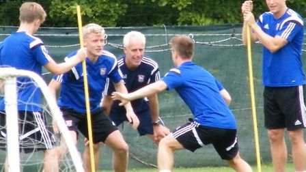 Ipswich Town boss Mick McCarthy watches new signing Jonathan Parr during a drill
