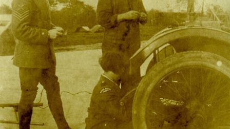 Constance Robson, the 'girl who would drive to hell backwards', working on a vehicle while her male