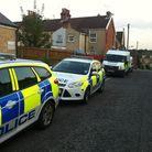 Police cars parked in Wilberforce Street last night.