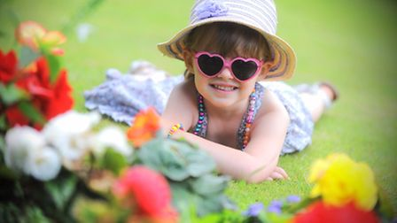 Hot weather pictures. Abbey Gardens, Bury St Edmunds. Pictured is Grace Hastings.