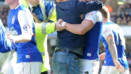 Aaron Cresswell needs to be rescued from an overzealous Town fan after Ipswich equalised at Watford