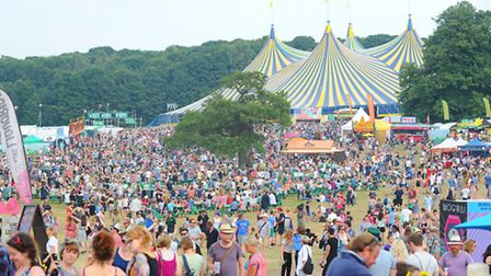 The Latitude Festival 2014 at Henham Park. The BBC Radio 6 music stage in the distance as people mak