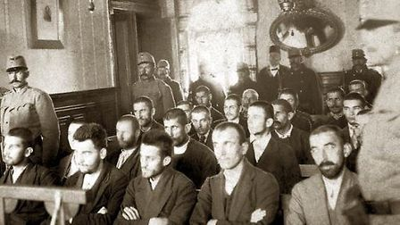 Gavrilo Princip at his trial about three weeks before Christmas, 1914. He's sitting in the middle of