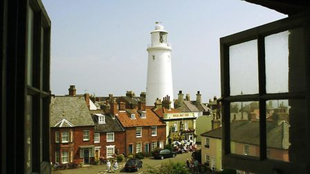 Southwold lighthouse seem from a window at the top of Adnams brewery.