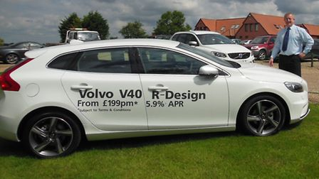 Julian King, general manager of M R King & Sons, with a Volvo V40 at the charity golf competition at