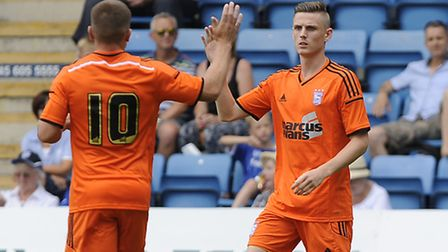 Alex Henshall gets a high five from Paul Taylor after putting Ipswich in front early at Gillingham o