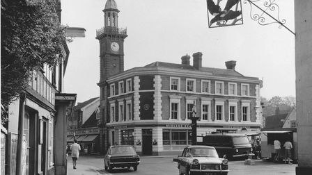 The market place looking towards The Throughfare at Harleston. Next to the Midland Bank is the clock