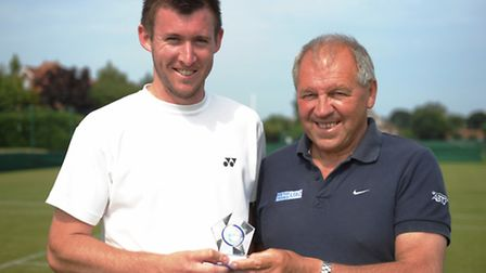 Matt Hough, left, shows off his winning trophy with referee Brian Carr