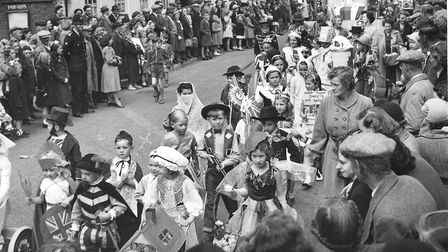 Harleston Coronation celebrations, children in fancy dress parading in the procession. One child is