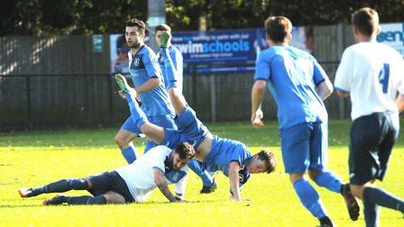 Action from Wroxham (blue) against Haverhill Borough at Trafford Park. Picture: Ian Burt