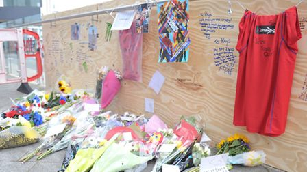 Tributes and flowers have been left outside UCS on the Ipswich Waterfront in memory to the boy who d